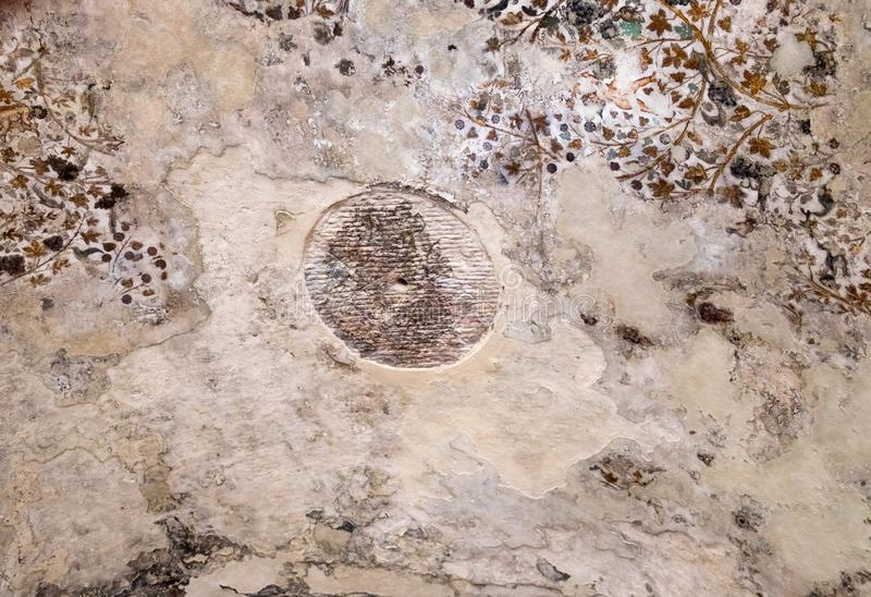 Fragment of ceiling painting inside rock house at Little Petra in the ancient Arab Nabataean Kingdom city of Petra stock photo