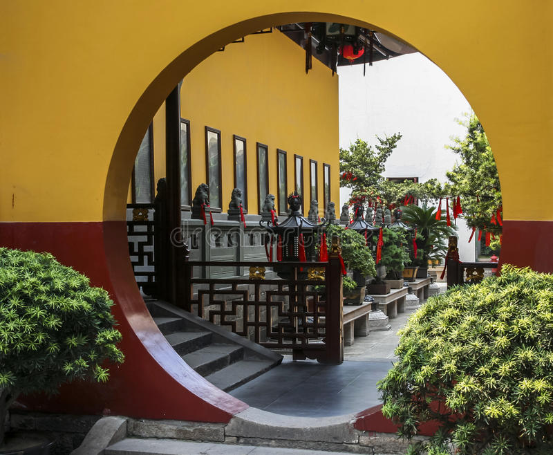 Download Fragment Of Chinese Temple With Row Of Bonsai Trees And Moon Gate Stock Image - Image: 34329901