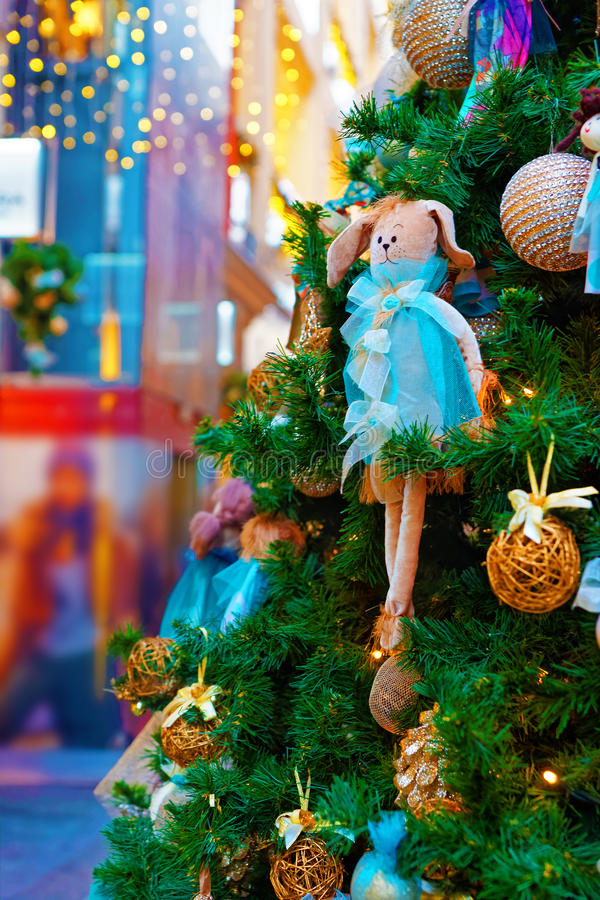 Fragment of the Christmas tree decoration - a lovely rabbit. In a blue dress royalty free stock photography