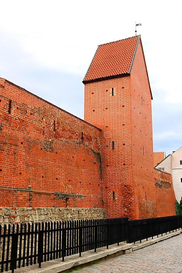 Fragment of the city wall and Ramera Tower on Torna Street. Riga. Latvia royalty free stock photo