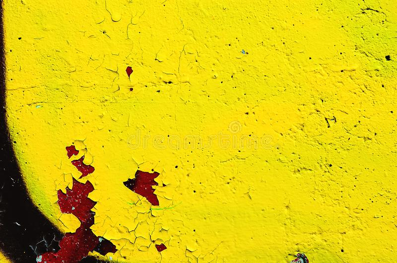 Fragment of the concrete wall, painted with yellow paint. Bright colorful background stock photography