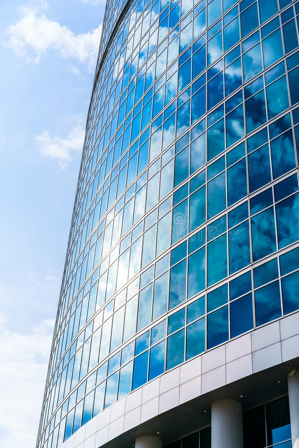 Fragment of contemporary architecture, walls made of glass and concrete. Glass curtain wall of modern office building royalty free stock images