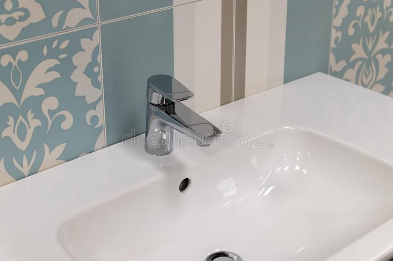 Fragment of conventional faucet in the bathroom. Fragment of a conventional faucet in the bathroom stock photography