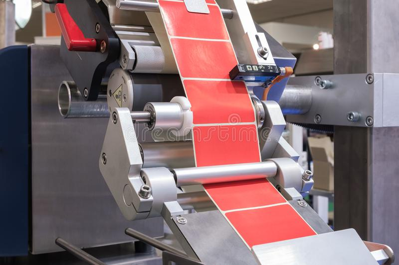 Fragment of the conveyor of the pharmaceutical labeling machine. Abstract industrial background stock images