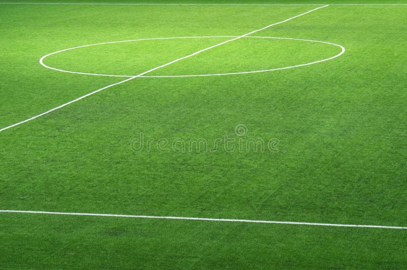 Fragment d'un terrain de football vert frais avec une inscription pour le fond photographie stock