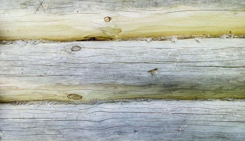 Fragment d'un vieux mur fait de rondins, fond abstrait de texture photographie stock libre de droits