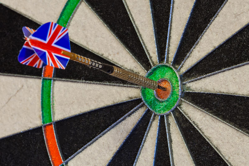 Fragment of dartboard with dart in bullseye royalty free stock photography