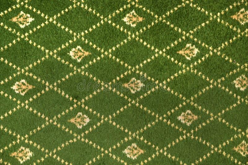 Fragment de modèle décoratif de tissu de tapis photo libre de droits