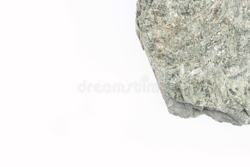 Fragment de roche sur le fond blanc - vue supérieure image stock