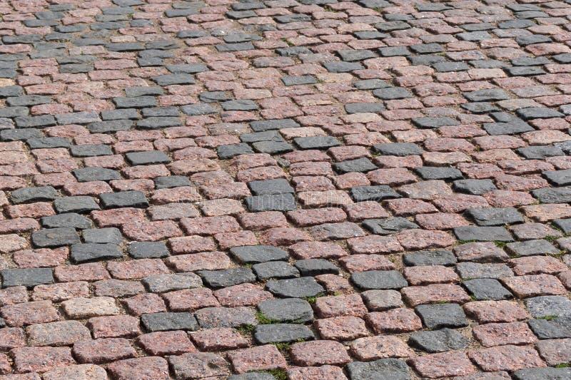 Fragment de vieille route de pavé rond, les pavés ronds image stock