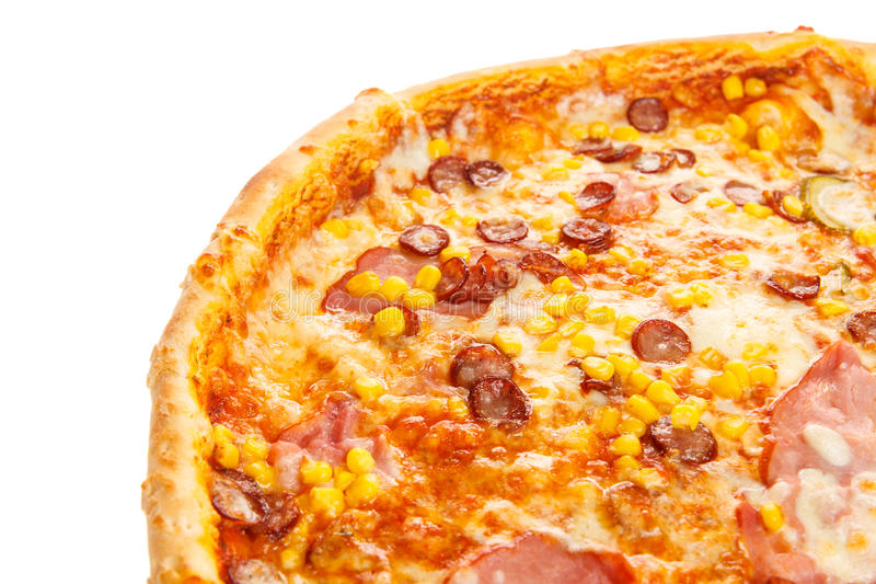 Fragment of delicious classic italian pizza with ham, sausages, corn, cucumbers and cheese stock images
