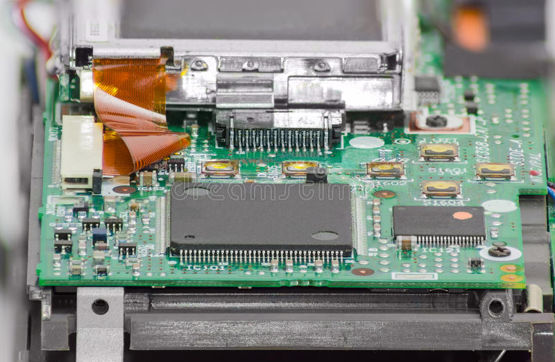 Fragment of electronic device with chips and other components cl. Fragment of electronic device with chips and other electronic components in foreground closeup royalty free stock photography