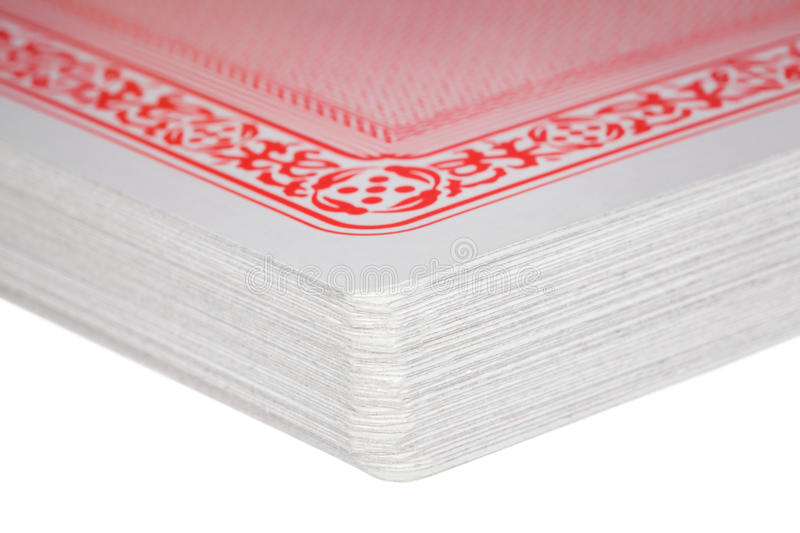 Fragment of exactly combined deck of playing cards. On white royalty free stock photos