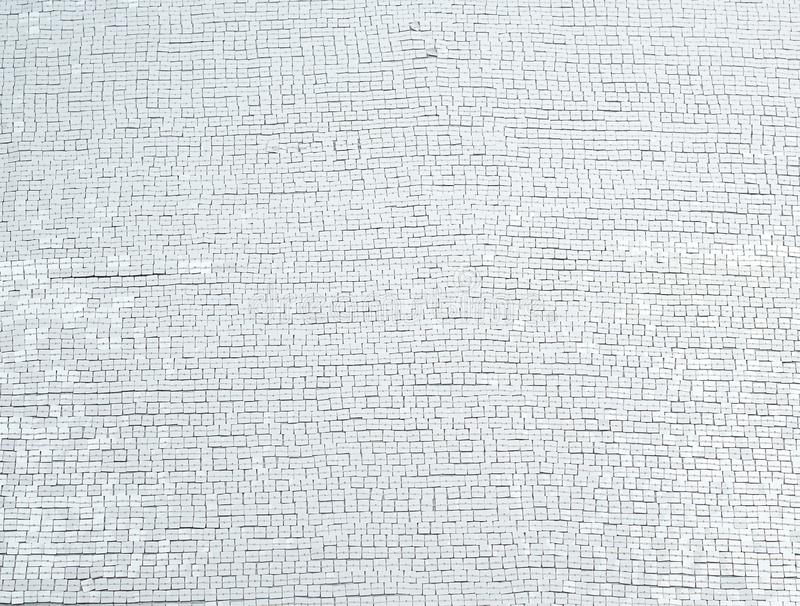Fragment of fabric embroidered with white square sequins, full frame. Close up stock images