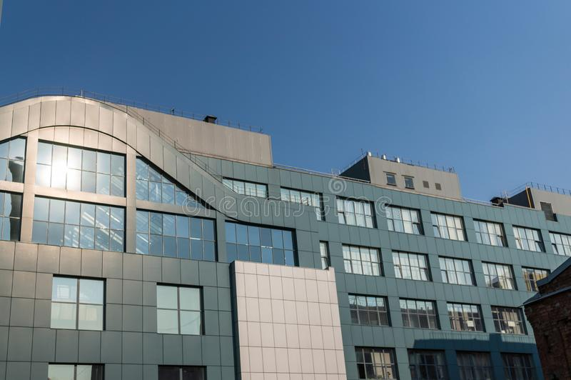 Fragment of the facade of a modern office building with panoramic windows stock photography