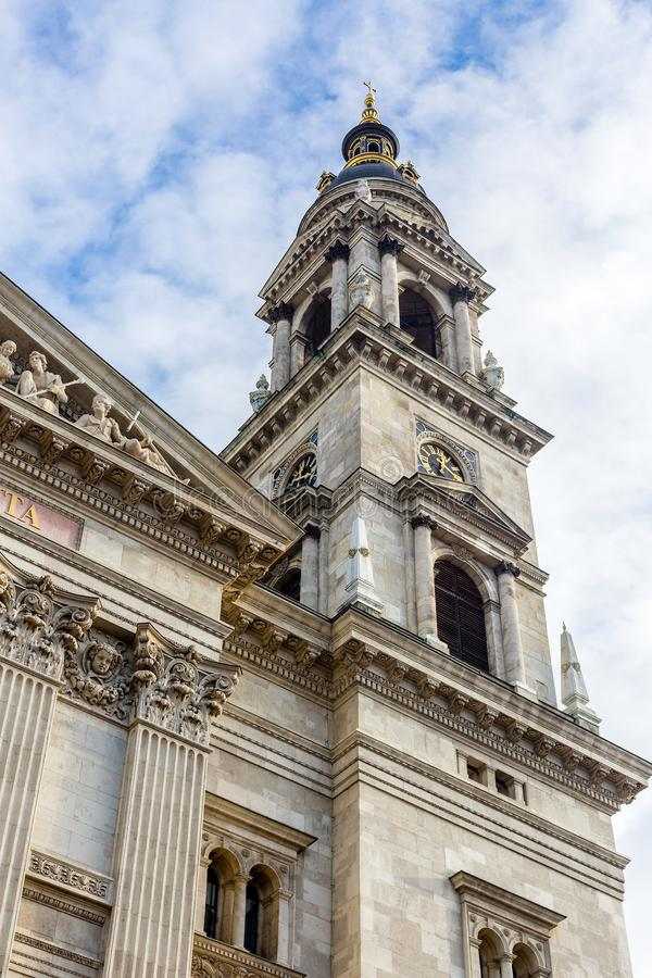 Fragment of facade of Saint Stephen Basilica, largest roman catholic church in Budapest. Bell tower with a clock. Fragment of facade of Saint Stephen Basilica royalty free stock photo