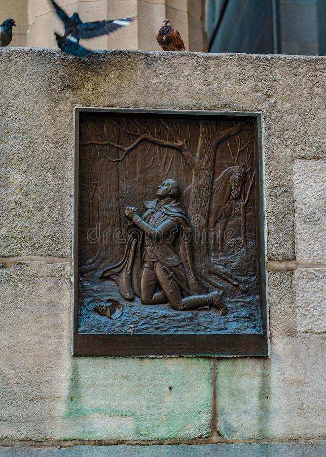 Fragment of Federal Hall with a bas-relief of WASHINGTON AT VALLEY FORCE and three pigeons Financial District, Manhattan NYC royalty free stock image