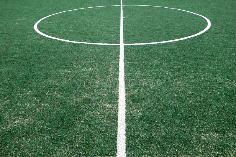 Fragment of footbal field with artificial grass royalty free stock image