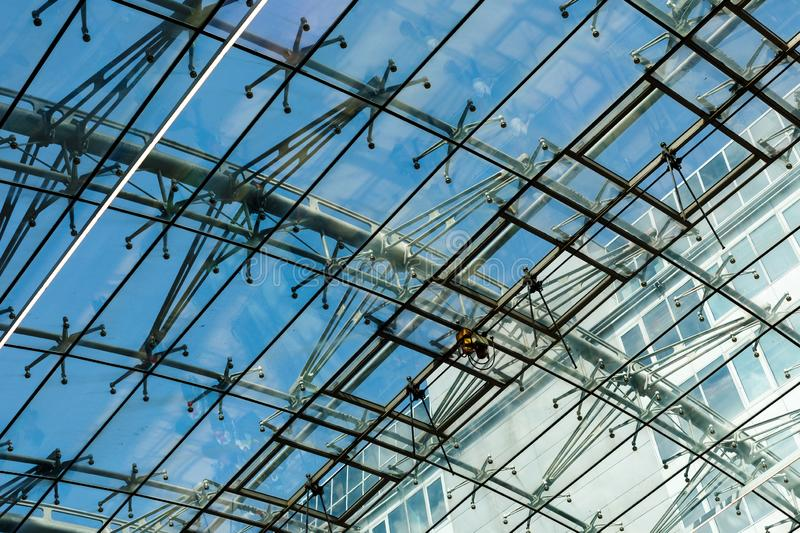 Fragment of a futuristic airport dome made of metal and glass royalty free stock photos