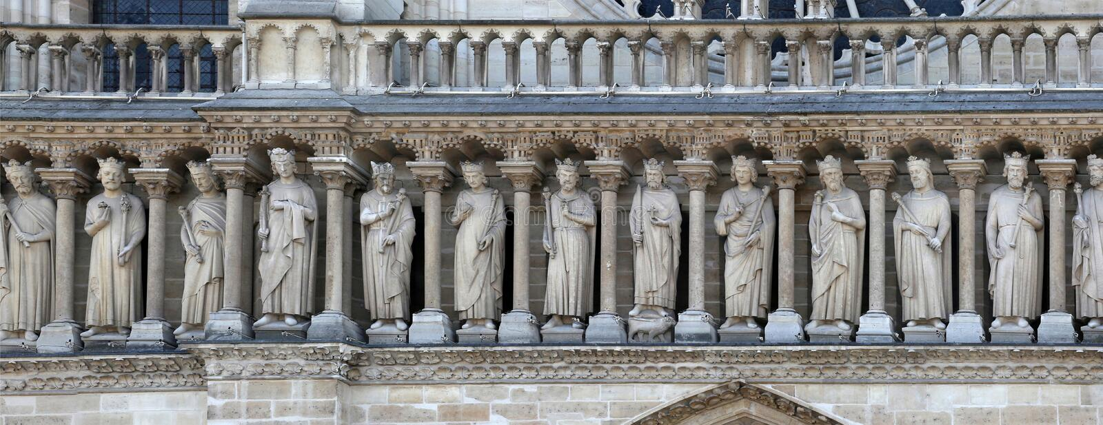 A fragment of the gallery of Old Testament kings on the façade of Notre Dame Cathedral. stock photo