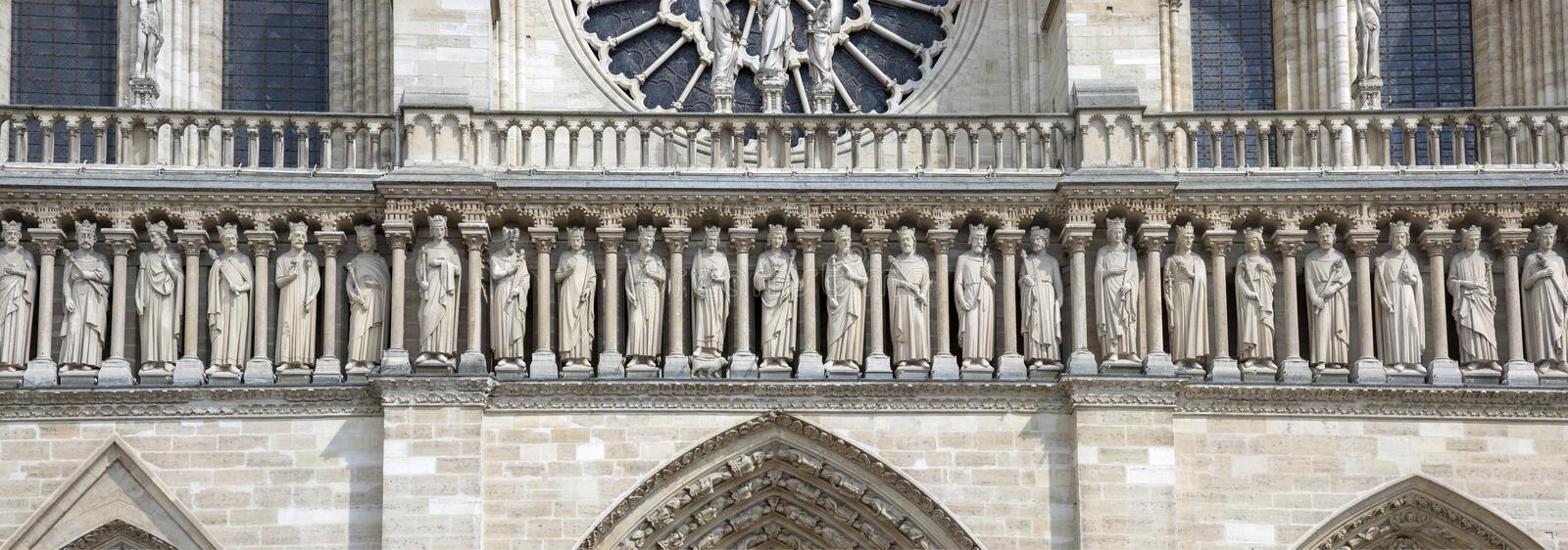 Fragment of the gallery of Old Testament kings on the facade of Notre Dame Cathedral.  stock photos