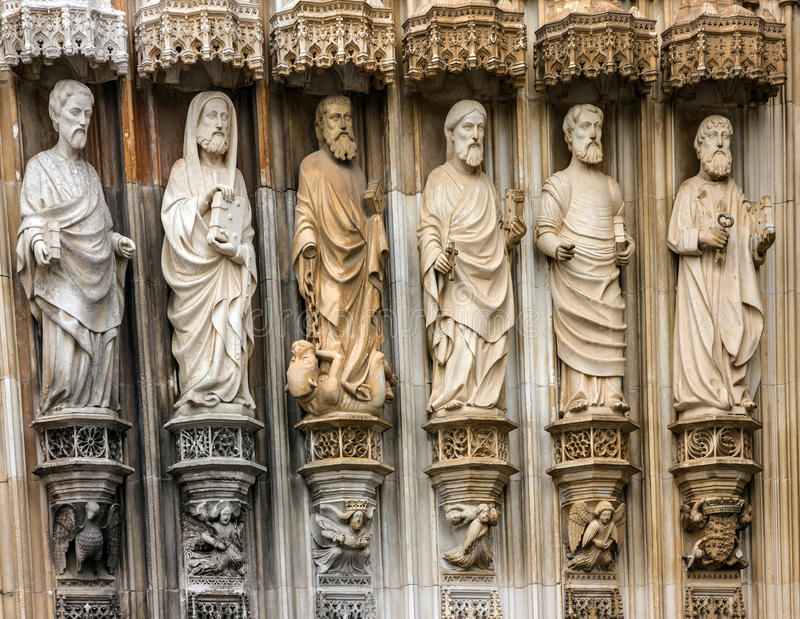 Fragment of gate with stone Apostles carving sculptural images,. Batalha Dominican medieval monastery, Portugal - great masterpieces of Gothic art. UNESCO World stock images