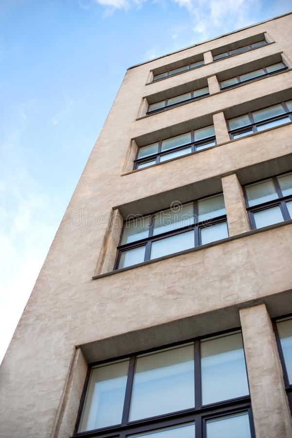 Fragment of a gray high-rise building built in the 1930s of the. 19th century, view from below stock images