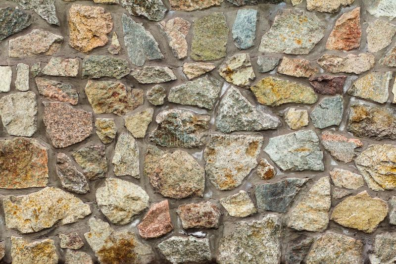 Fragment of gray stone wall. Front view royalty free stock photography