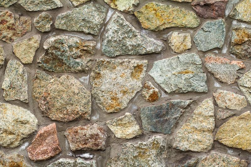Fragment of gray stone wall. Front view stock images
