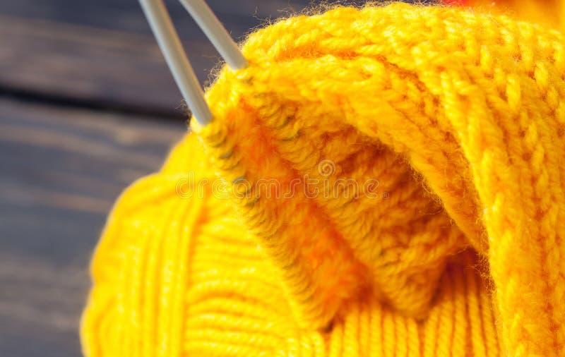 Fragment of a hand knitting. Closeup shot royalty free stock photo