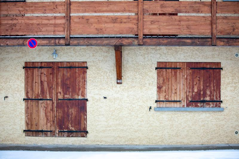 Fragment of house with closed window and door stock photo
