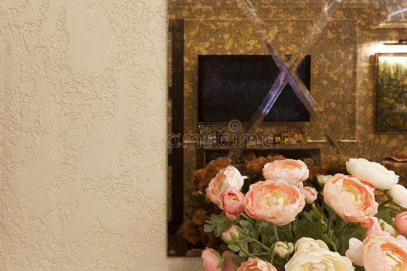 A fragment of the interior in the apartment. Wall with a mirror and stucco stock photography