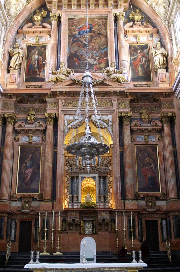 Fragment of the interior of the Catholic Church. Part of the Catholic Christian Cathedral in Spain. Altar part of the temple. Religious symbols, paintings and stock photo
