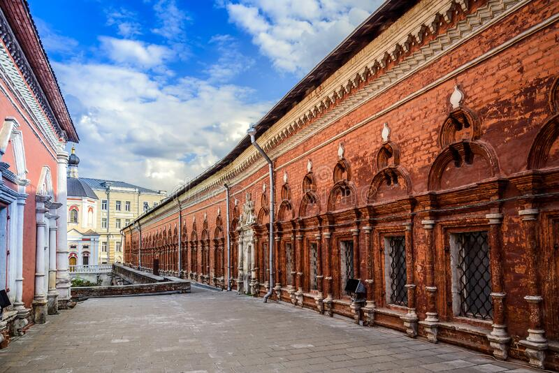 A fragment of the interior of the courtyard and a view of the fraternal cells of the Vysoko-Petrovsky Orthodox Monastery. Moscow. royalty free stock image