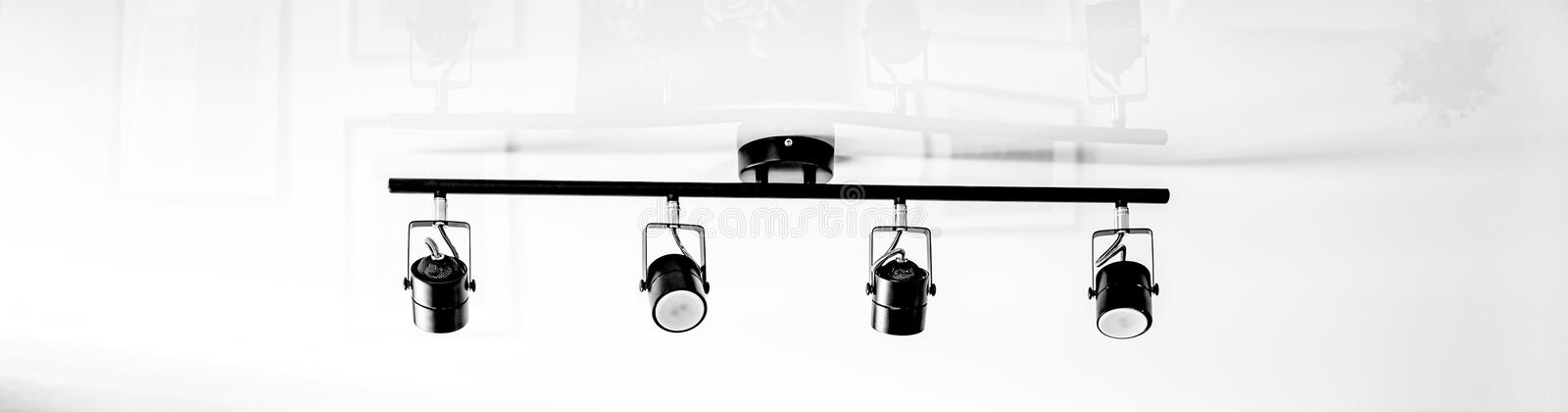 A fragment of the interior of the home loft lighting. Abstract lamp in the form of a soffit in daylight. stock images