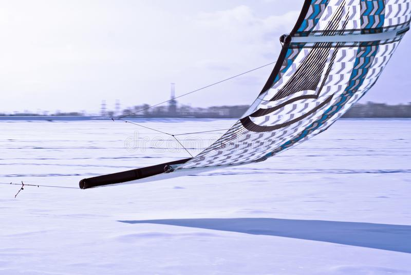 Fragment of a kite for snowkiting, rushing low over the ice royalty free stock photo