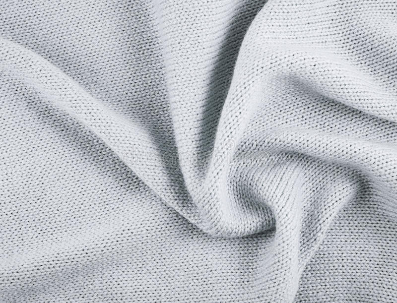 Fragment of a knitted piece of cloth royalty free stock photo