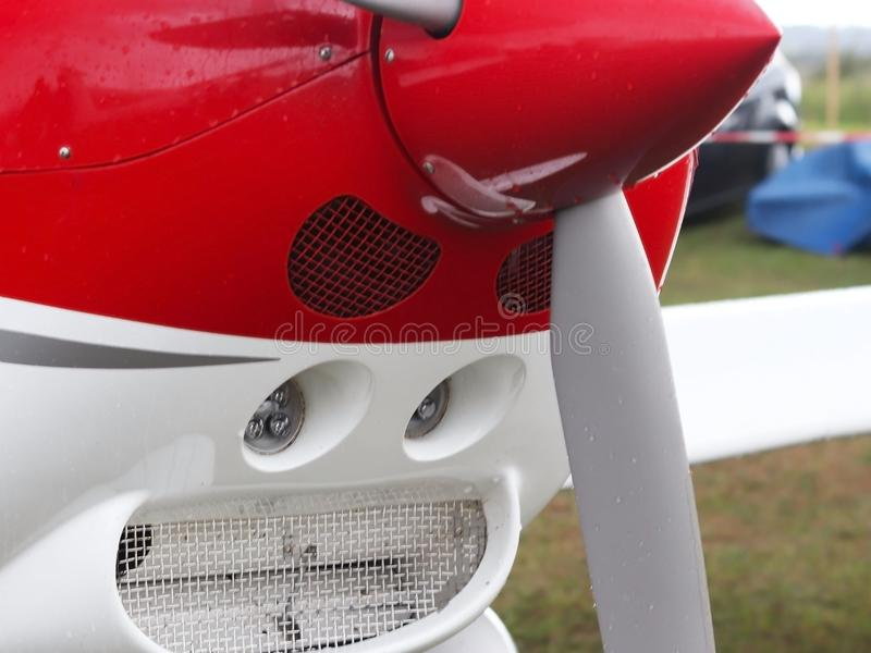 Fragment of a light two-seater sports airplane in raindrops. Exhibition, competitions and airshow. Hobbies and free time. Festival. And festival for the public stock photo