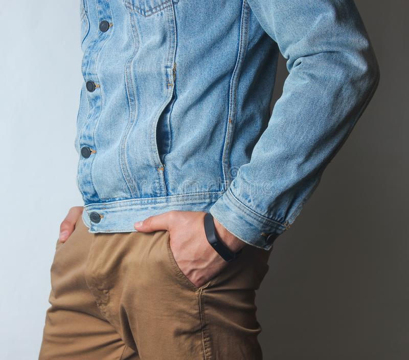 Fragment of a man dressed in a denim jacket stock photography