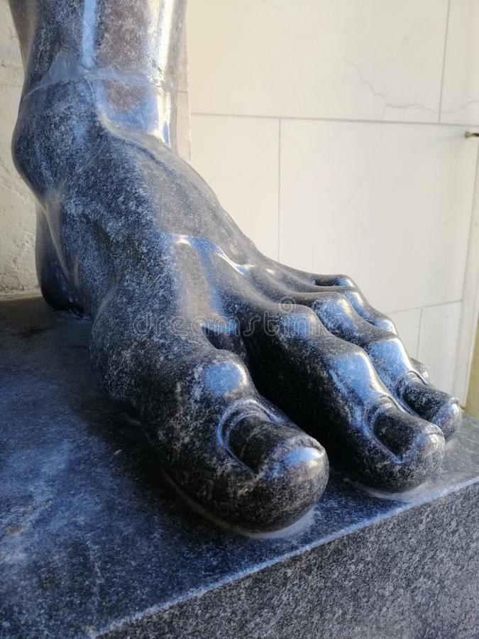 Fragment of the marble foot. Of Atlanta stock image