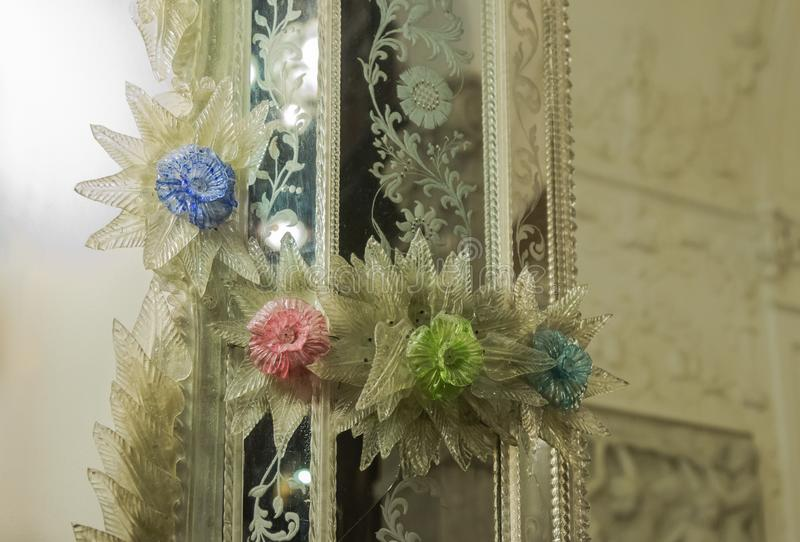 Fragment of a mirror decorated with glass flowers in the Peles castle in Sinaia, in Romania royalty free stock photography