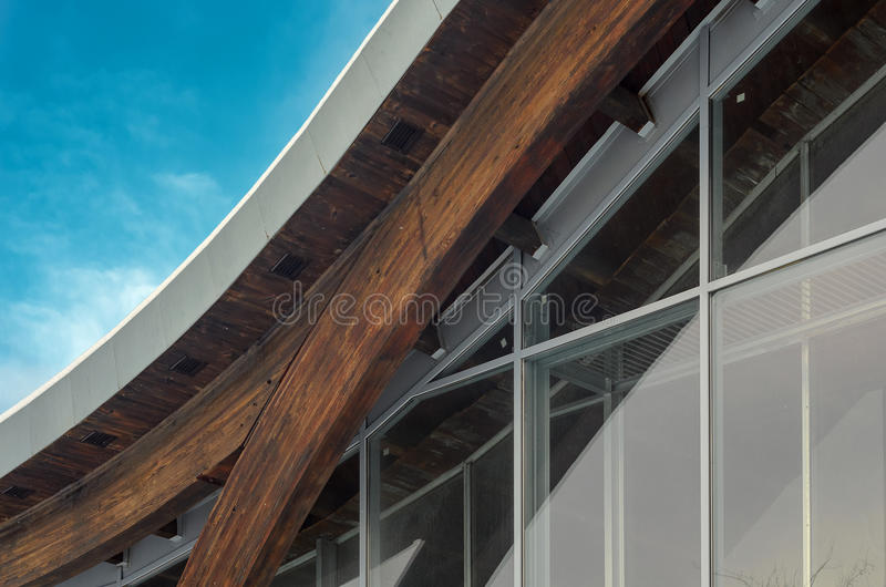 Fragment of modern building with structural glass wall. MINSK, BELARUS - January 15, 2017: Sports complex Olympic reserve. Pool National Olympic Training Center royalty free stock photo