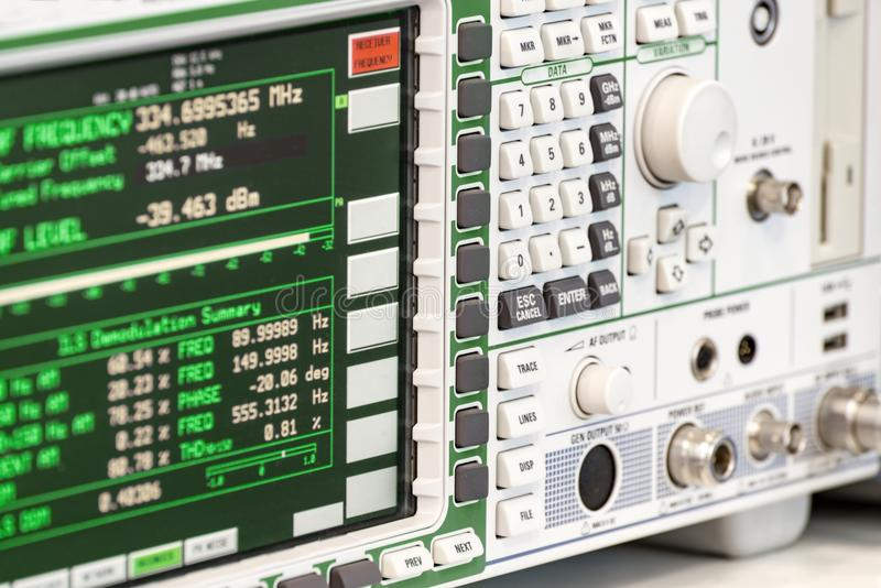 Fragment of a modern digital oscilloscope. Scientific measuring equipment. stock photography