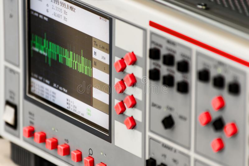 Fragment of a modern digital oscilloscope. Scientific measuring equipment. stock photo