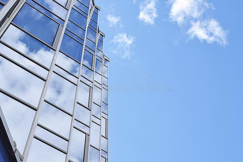 Reflection of the sky in the glass facade of the building royalty free stock photos