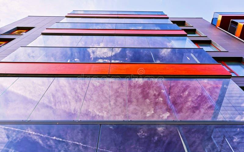 Fragment of Modern glass residential building reflex stock photos