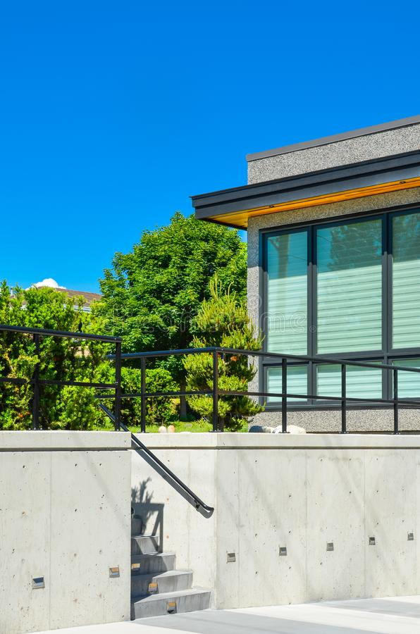 Fragment of modern house on land terace with concrete stairs to the upper land. royalty free stock images