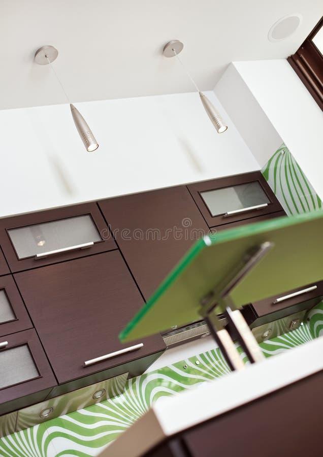 Fragment of modern Kitchen with hardwood furniture stock image