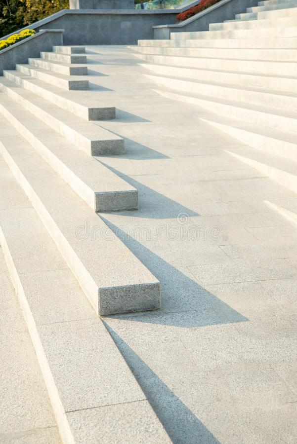 A modern stylish bright city stairs made of granite with a shadow from the sun royalty free stock photography