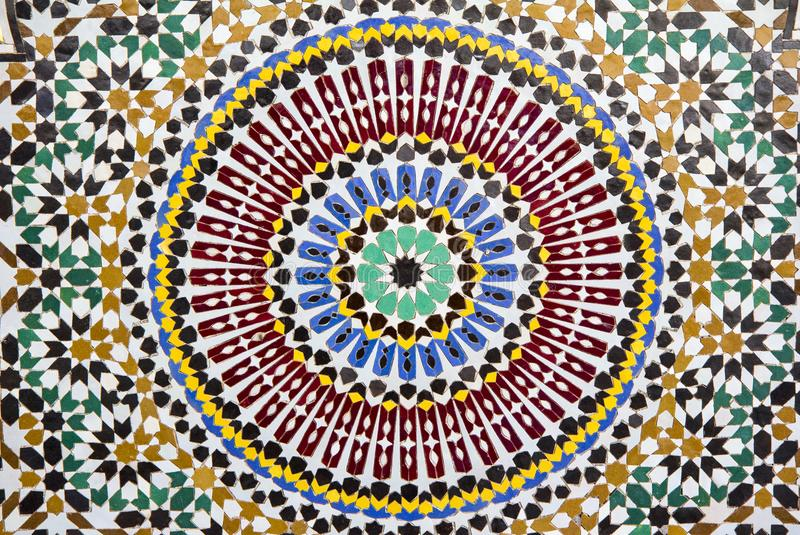 Fragment of Moroccan fountain decorated with small hand made tiles stock photography
